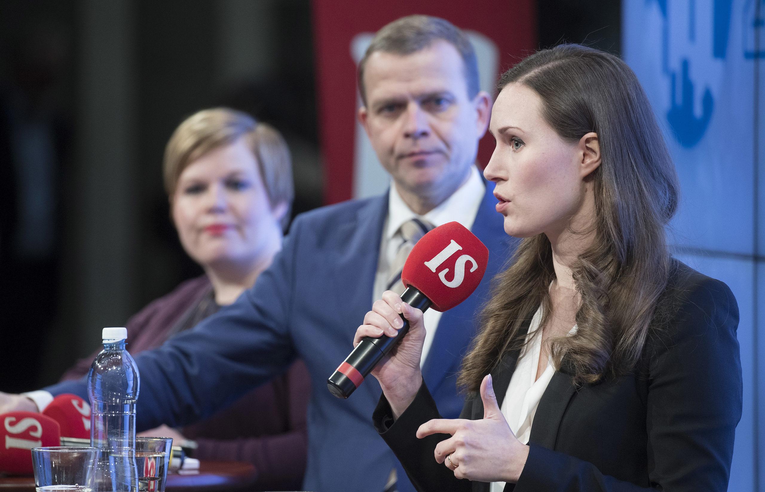 Annika Saarikko (kesk), Petteri Orpo (kok) ja Sanna Marin (sdp) vaalitentissä tammikuussa.