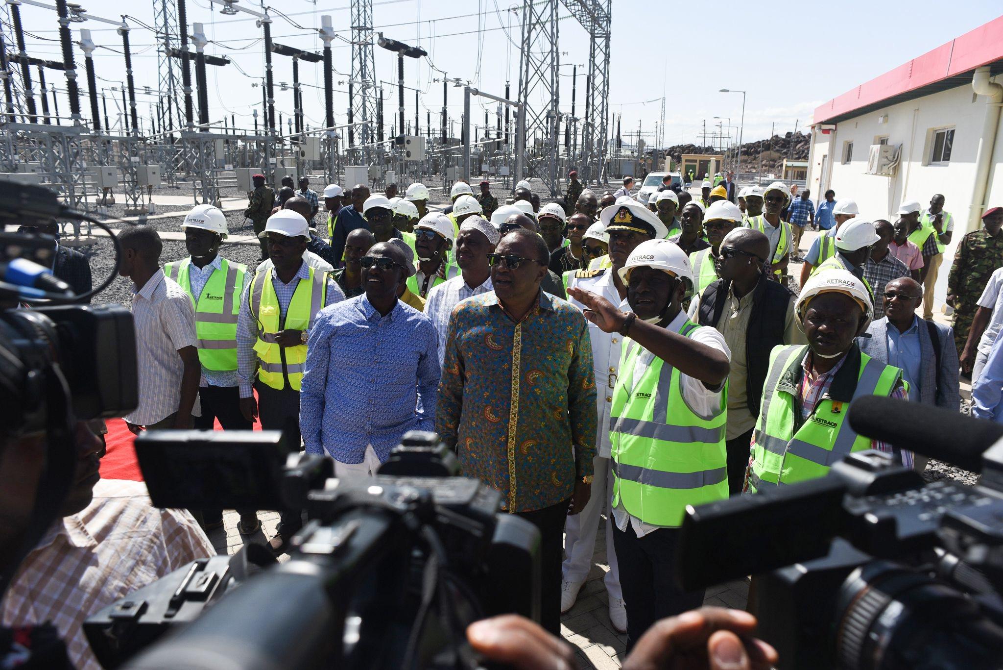 Kenyan President Uhuru Kenyatta inaugurates the 310 megawatt renewable energy project in Loiyangalani, Marsabit County, on July 19, 2019. - Some of the 365-turbines make the Lake Turkana Wind Power project, the largest of its kind in Africa. LEHTIKUVA / AFP  Nick Perry